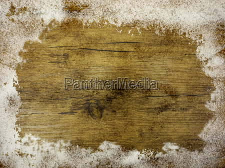 snow on a wooden plate