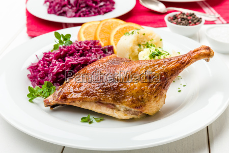 duck with dumplings and red cabbage