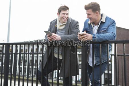 two men talking in the city