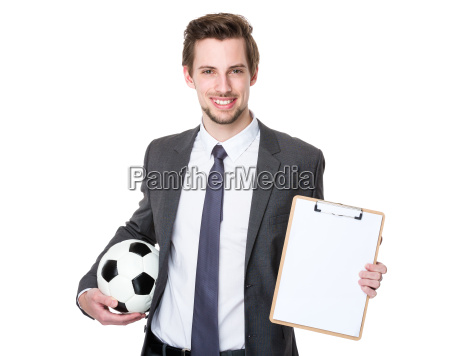 man wearing business suit and holding