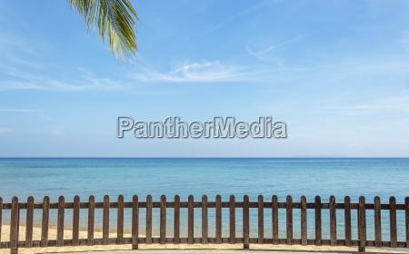 wooden railing facing to blue ocean