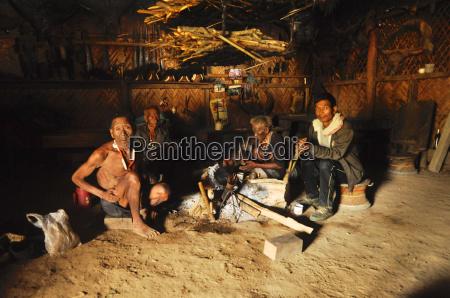 men around fire in nagaland india