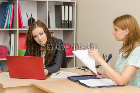 office specialist intensely looking for information