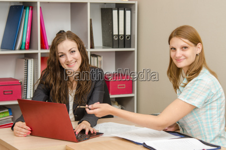 two employees discussing the electronic document