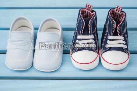 pair of dark blue white baby