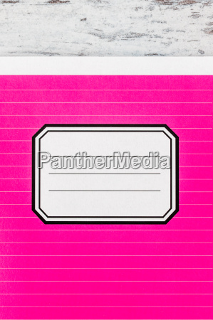 pink notebook with name label on