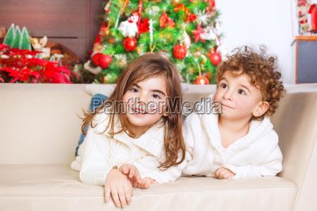 brother and sister enjoying christmas