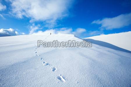 traveling along snowy mountains