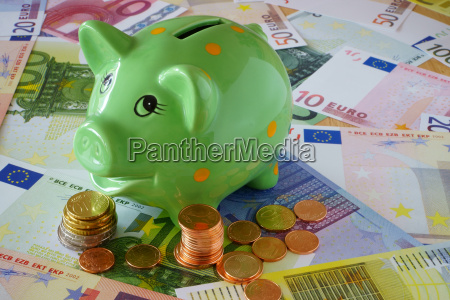 piggy bank euro bills and coins