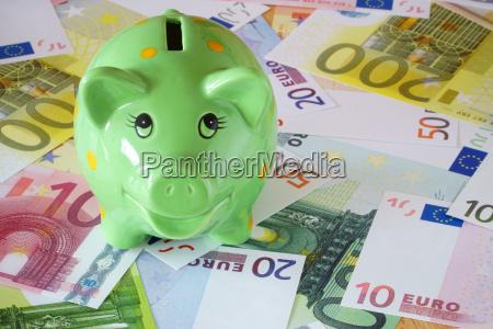 green piggy bank and euro bank