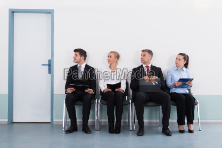 businesspeople sitting on chair for giving