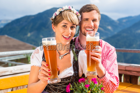 couple at mountain hut drinks white