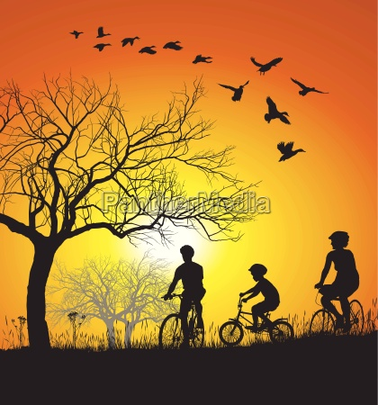 family cycling in the countryside at
