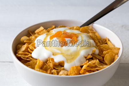 cornflakes in a bowl with yogurt