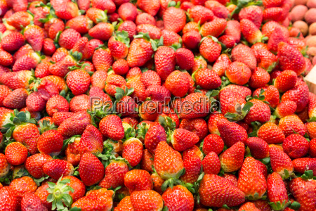 lots of strawberries at a market