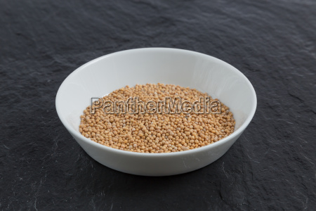 mustard seeds in a dish on