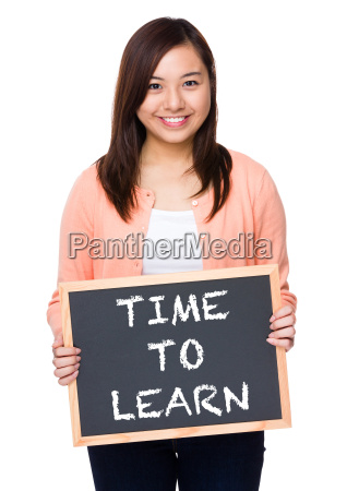 asian woman with black board showing