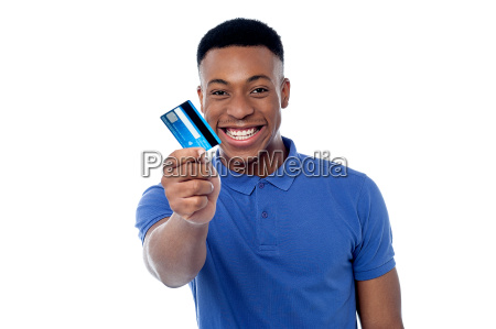 young guy offering credit card