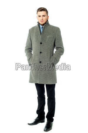 handsome elegant man in overcoat isolated