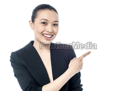 female executive pointing at something