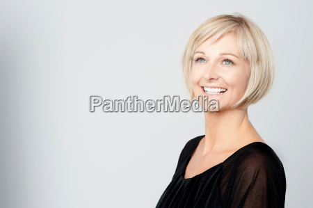 smiling middle aged lady looking upwards