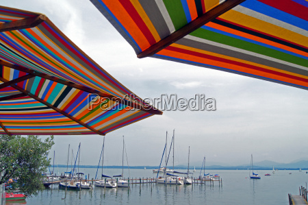 colorful umbrellas overlooking the chiemsee with
