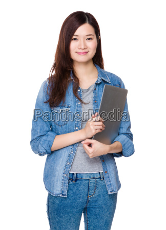 asian young woman hold with laptop