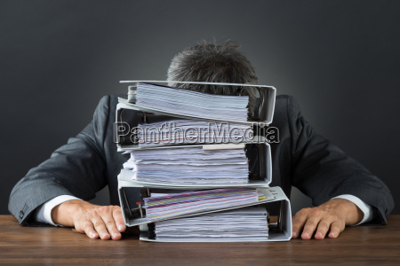frustrated businessman with lot of files