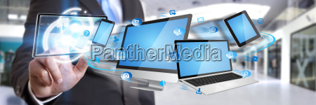 businessman holding tech device in his