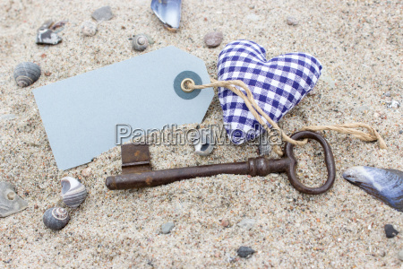 old key with keychains and heart