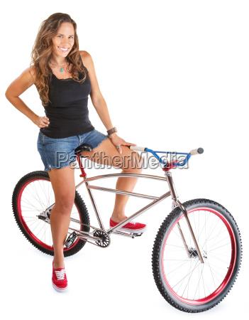 smiling woman on mountain bike