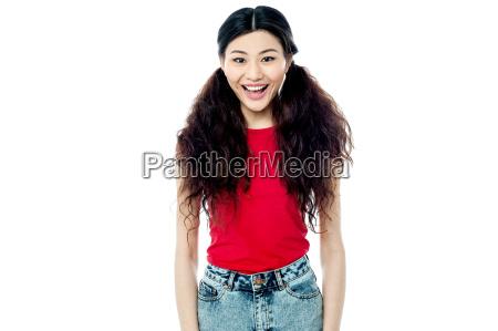 adorable smiling girl posing over white