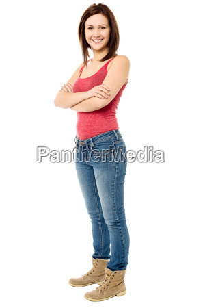 young woman posing in trendy casuals