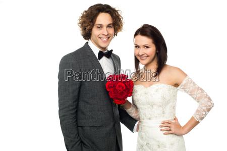 adorable wedding couple posing
