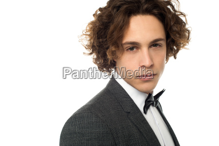 male model in tuxedo isolated over