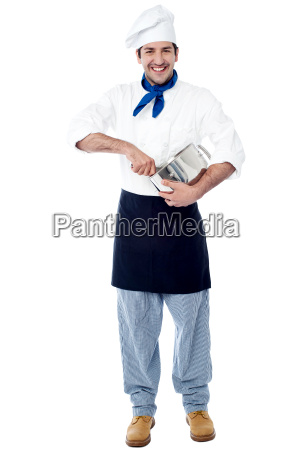 isolated chef posing with utensil