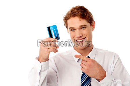 smart businessman showing credit card