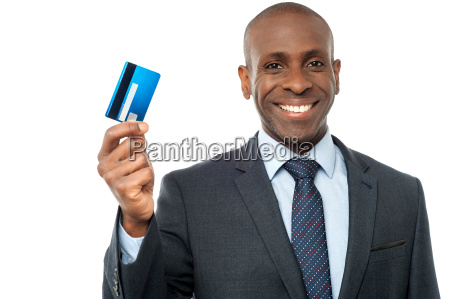 smiling corporate guy showing credit card