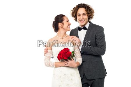 beautiful bride looking at her man