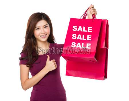 happy shopping young woman with thumb