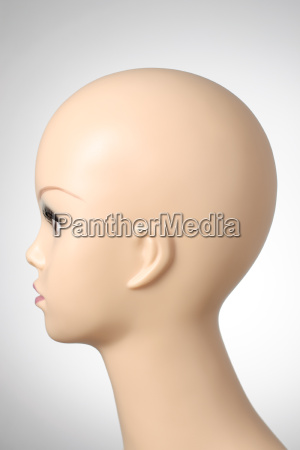 mannequin head on grey background