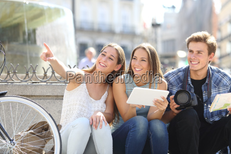 tourist friends searching locations