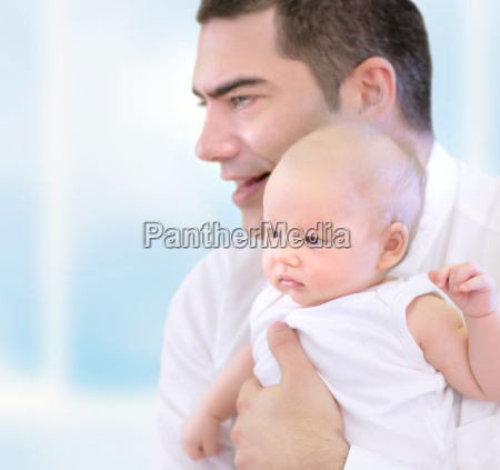 happy father with little baby