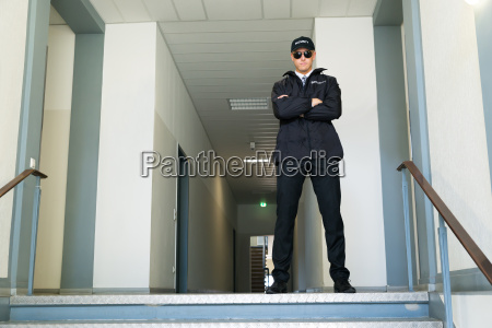 security guard standing at the entrance