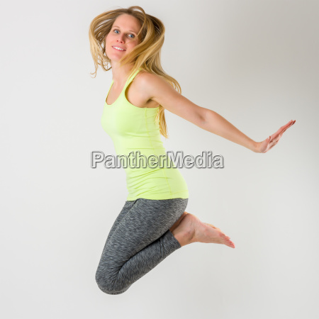 blond athletic woman jumping in the