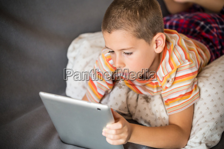 boy looking at touch pad
