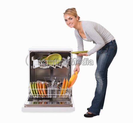 woman arranging utensils in dishwasher over