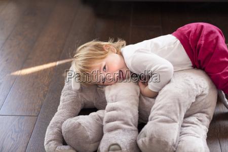 happy baby embraced elephant plush