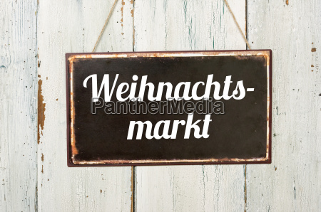 old metal sign against white wooden
