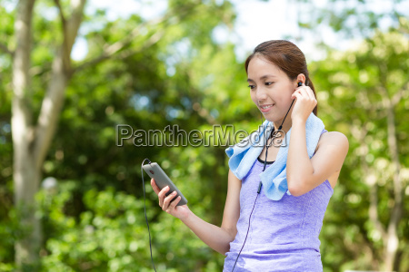 asian woman listen to music with